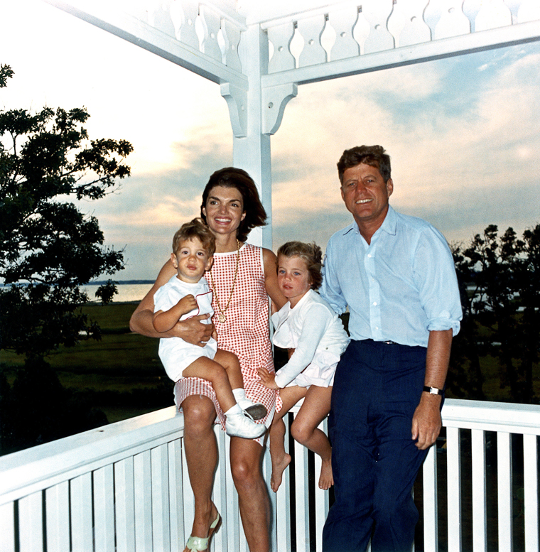 ST-C22-1-62 04 August 1962 President Kennedy and family, Hyannis Port. L-R: John F. Kennedy Jr., Mrs. Kennedy, Caroline Bouvier Kennedy, President Kennedy. Photograph by Cecil Stoughton, White House, in the John F. Kennedy Presidential Library and Museum, Boston.
