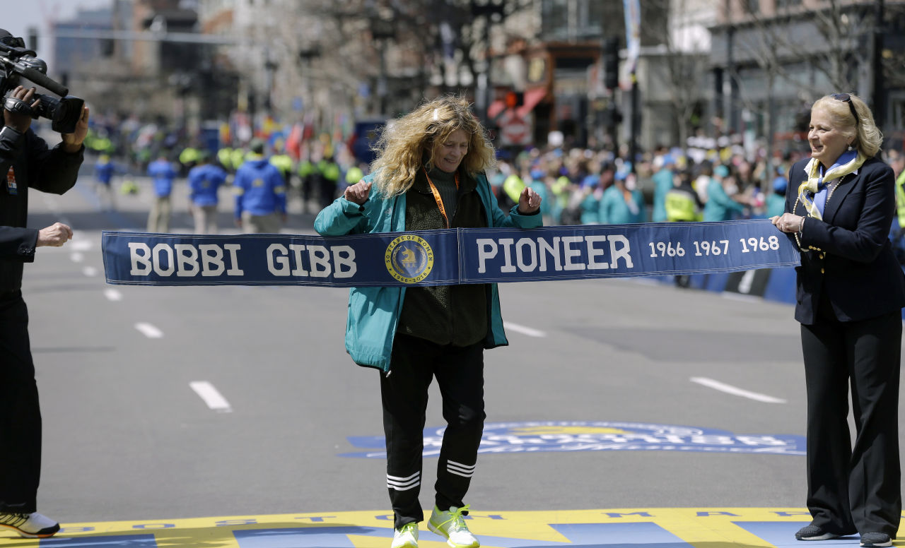 Bobbi Gibb, first woman to run the Boston Marathon in 1966, crosses at the finish line of the 120th Boston Marathon on Monday, April 18, 2016, in Boston. (AP Photo/Elise Amendola)